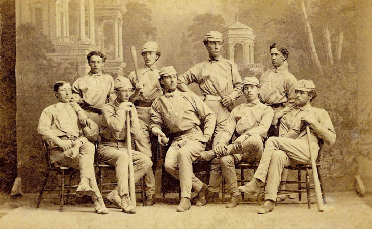 Baseball history photo: The 1869 Antioch College Club which was beaten by the Red Stockings 45-10 on October 24, 1869 in Yellow Springs, Ohio. Front row (L to R): Hod Frost, Right Field; Thad Carr, Catcher; Hugh Taylor Birch, Pitcher; Arthur Elliott Third Base; Dan Stone, Left Field.  Back Row (L to R): Cliff Bellows, Second Base; Sam Beals, First Base; Matt Corry, Center Field; Edward Felthausen Short Stop.  Click photo to return to previous page.