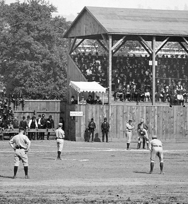 Baseball history photo: Baseball game between Lima (Ohio) and Wheeling (West Virginia), circa 1887. Note the chalked outline of the pitcher's box and the pitcher standing with one foot on the back line of the pitcher's box (a requirement beginning in 1887).  Click photo to return to previous page.