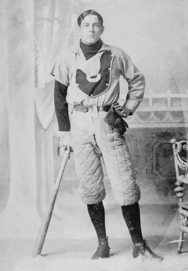 Baseball history photo:  Arthur Van Winkler, Centre College baseball player, 1891. Note the primitive fielder's glove, devoid of padding.  Even by 1891, gloves for players other than the catcher were slowly developing.  Winkler may have been a pitcher as is evidence to the fact that his right uniform sleeve has been tailored into a short sleeve.  The bat he is leaning on shows only small taper from the 2½ inch barrel to the handle which was the standard in the 19th century.  Winkler's baseball pants are also fully padded as seen by the quilt stitched pattern.  Ads for sliding pads first appeared in the 1887 Spalding's Official Base Ball Guide as Morton's Patent Sliding Pad.  This was a quilted piece of material that was strapped to the player's leg, on top of his pants, covering the hip and thigh just above the knee.  It was available in chamois and canvas and according to the ad, Its use increases a player's confidence, and renders the act of sliding free from danger. The following year Spalding offered baseball pants with the padding stitched into the game pants, at an extra cost, as well as the Morton sliding pad.  Click photo to return to previous page.