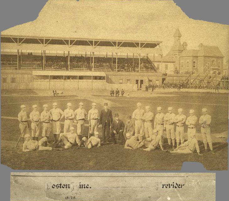 Baseball history photo: 1879 - Messer Park Providence, Rhode Island. Taken in the spring of 1879, this photo shows the 1878 National League Champion Boston Red Caps on the left and the Providence Grays on the right, who were the National league champions in 1879. Messer Park opened in 1878 and had a seating capacity of 6,000. A wire screen was installed behind home to protect the spectators from foul balls and the field was exceptionally smooth for it's time. Note the chalked four foot by six foot pitcher's box, with its front line 50 feet from home base, marked on the field. A few players are identifiable.  For Boston (L to R): Tommy Bond, Pitcher (standing, third from left); John Morrill, Third Base (standing, fifth from left); Charley Jones, Left Field (left of Morrill) and Manager Harry Wright is seated in the dark suit.  For Providence (L to R): Bobby Mathews, Pitcher (first standing); Jim O'Rourke, Right Field (standing, third from left); Joe Start, First Base (standing, fourth from left); John M. Ward, Pitcher (standing, fifth from left);  Paul Hines, Centre Field (standing, far right) and George Wright, Short Stop (reclining, middle). Click photo to return to previous page.