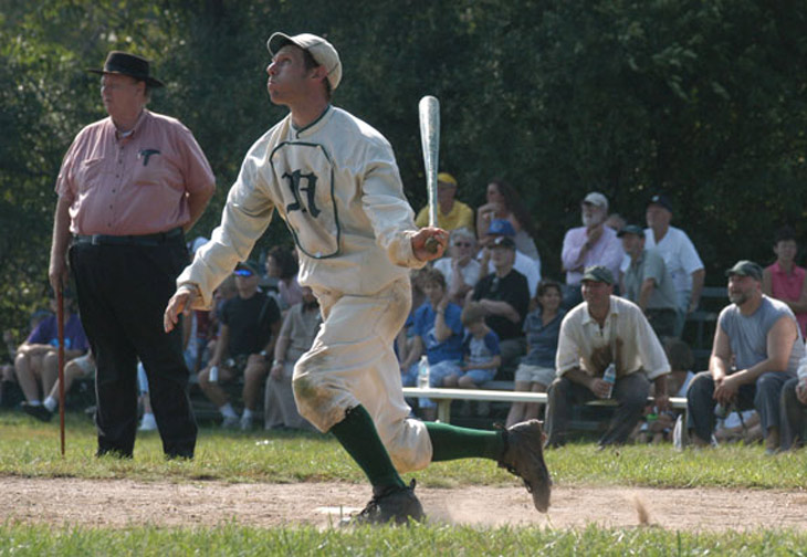 "Vintage baseball photo: August 28, 2005 - Woodbury, CT.  Eric ""Express"" Miklich of the NY Mutuals BBC.  The 21st century NY Mutuals are committed to increasing the public's knowledge of 19th century base ball.  Being hired for community and public events, such as this 1864 match in Woodbury, allows the Mutuals to demonstrate various styles of play in the 19th century and lecture on the history and rules regarding baseballs beginnings. The Umpire shown in the photo is Harry Higham who is the great grandson of Dick Higham, professional baseball player and the NY Mutuals' first captain.  Photo by R.C. Shaw.  Click photo to return to previous page."