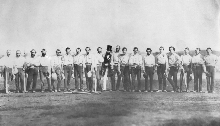 Baseball history photo: This photograph, taken by Brooklyn photographer Charles H. Williamson, depicts the Knickerbocker Base Ball Club and the Excelsior Base Ball Club in one of the earliest known team photos and perhaps the first image on a baseball field.  It was taken on September 3, 1859, at Elysian Fields, Hoboken, New Jersey.  Some of the players are as follows; Knickerbockers—James Whtye Davis (second from left), Charles Schuyler De Bost (third from left) and Harry Wright (sixth from the left).  The umpire is Dr. J.B Jones (middle in overcoat and hat) and the Excelsiors are—Henry D. Polhemus (Jones's left), John Holder (Sixth from right), Edwin Russell (fifth from right) and Thomas Reynolds (far right). Click photo to return to previous page.