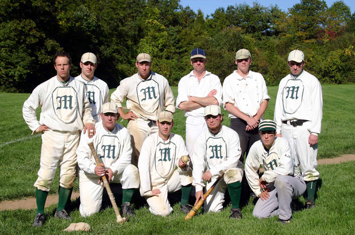 "Vintage baseball photo: 10/08/06 - The New York Mutuals at Old Bethpage Village Restoration.  Standing (L to R): Eric ""Express"" Miklich, Rich ""Canada"" Harinsky, Ray ""Youngblood"" Hippeli, Chris ""Chops"" Lamb, Pete ""Wheels"" Halecky, Tom ""Kick"" Halecky.  Front Row (L to R): Tom ""Rabbit"" Blair, Tom ""Squid"" Jordan, Tom ""Dirt"" Fioriglio, Alex ""Guppy"" Banyazs.  Photo by Bill Staskel.   Click photo to return to previous page."