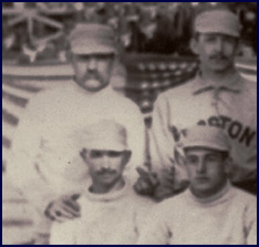 "Detail from 1886 Boston/New York team photo. The only pitcher in the history of major league baseball to win 60 games in a single season, Charles ""Old Hoss"" Radbourn extends his middle finger towards the camera. Click to enlarge."
