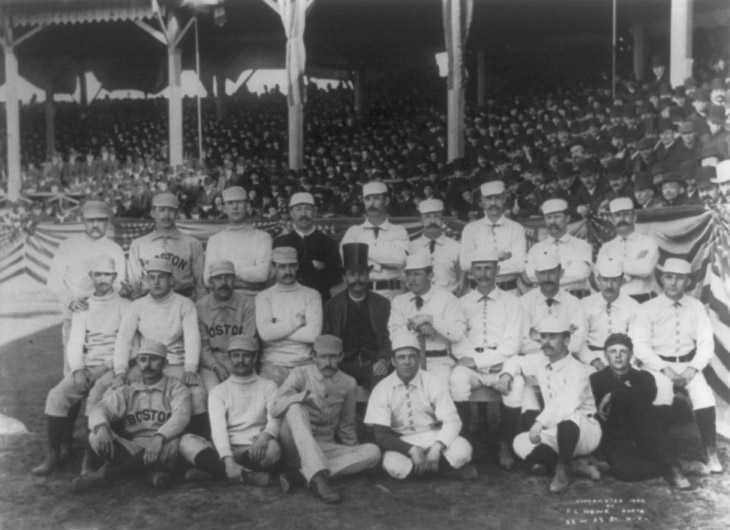 "Baseball history photo: 1886 Boston/New York team photo. Charles ""Old Hoss"" Radbourn is first from left standing with middle finger covertly extended. Click photo to return to previous page."