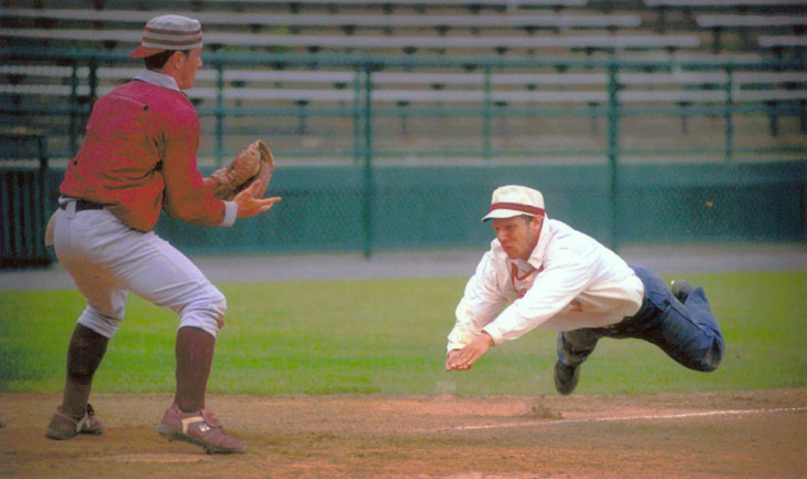 "Vintage baseball photo: June 12, 1998: Eric ""Express"" Miklich sliding home for the Brooklyn Atlantics (NY) in an 1887 rules match against the Glen Head Zig Zags (NY) on Doubleday Field in Cooperstown, New York.  Photo by Tom Ferrara.  Click photo to return to previous page."